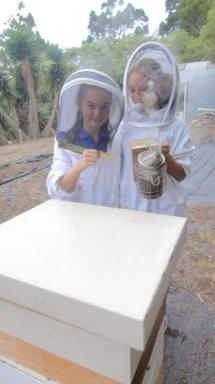 Both girls - showing hive tool and smoker